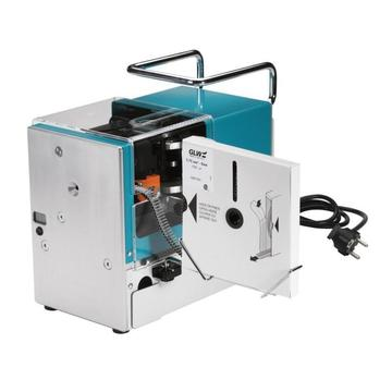 Machine for simultaneous stripping of cables and crimping of insulated end sleeves in strips